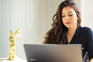 Female attorney working on laptop